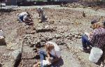 Recording the cobble-stone foundation of a mission period adobe building